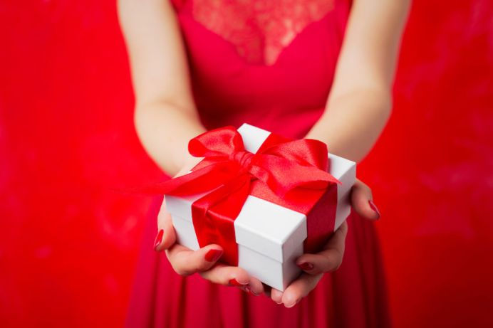 49294614 - woman holding christmas present
