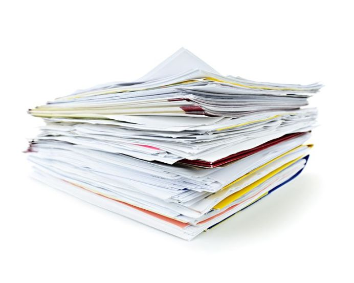 10500867 - stack of file folders with papers on white background
