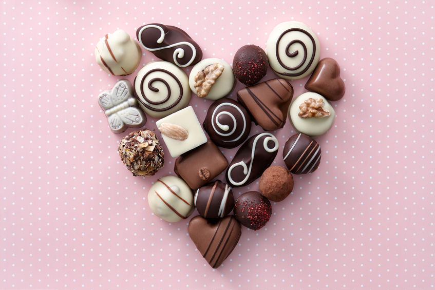 51171579 - chocolate candies heart shape composition. sweet gift of love for st. valentines day.