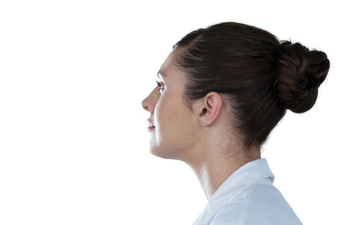 65412251 - side view of thoughtful female scientist looking away against white background
